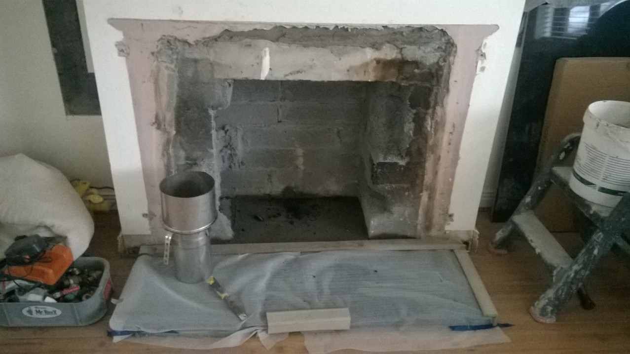 This is with the fireplace removed, before the stove was installed.