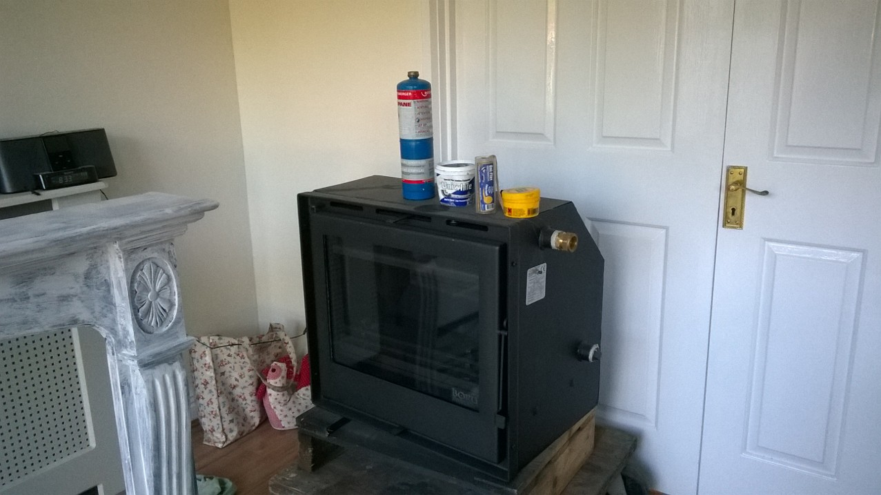 The Wood Stove and Back Boiler before installation. Kind of looks like an old TV.