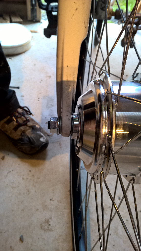 The electric wheel goes onto the frame just like any wheel, though it needs forks to be 100mm wide.