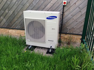 An Air Source Heat Pump hooked up to a house
