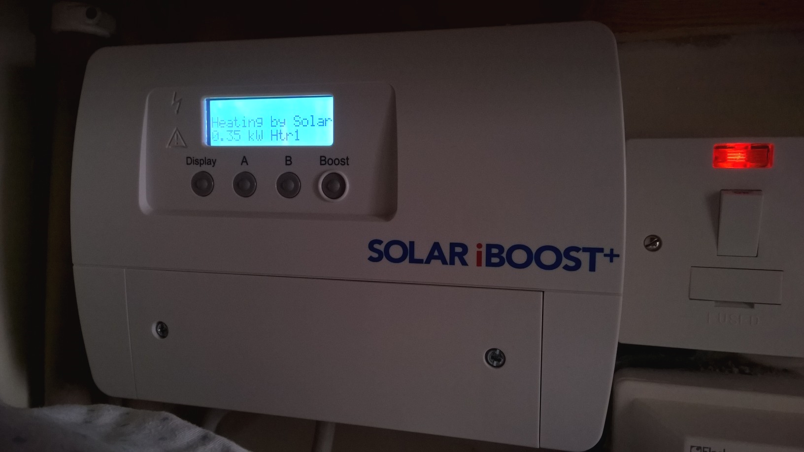 iBoost Hot Water Diversion Unit. It puts excess Solar generation (when the Solar panels are producing more energy than the house is consuming) into the hot water tank by heating water.